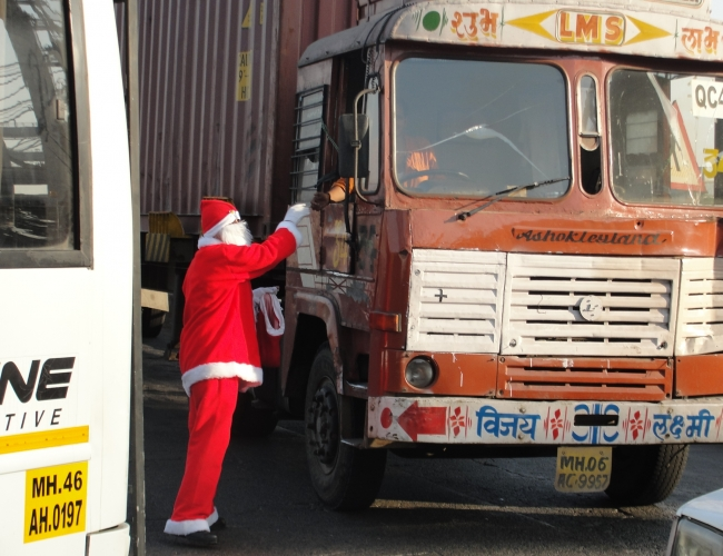 Santa Claus Giving Gift to Driver